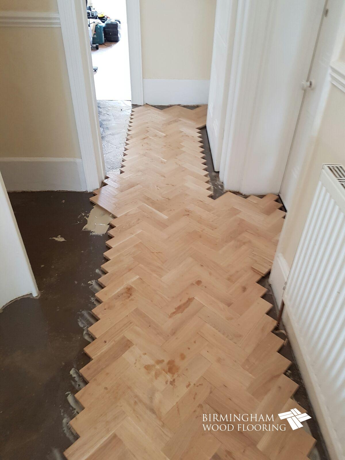 Installation-of-parquet-blocks-either-side-of-header-line-Edgbaston-Birmingham-2