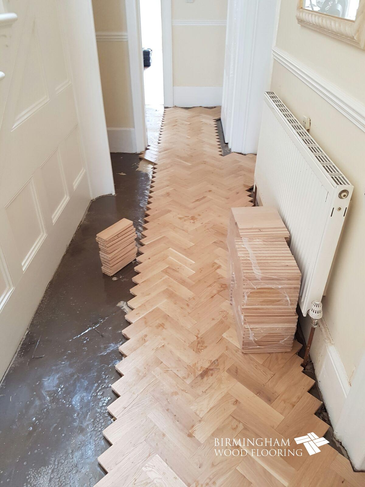 Installation-of-parquet-blocks-either-side-of-header-line-Edgbaston-Birmingham
