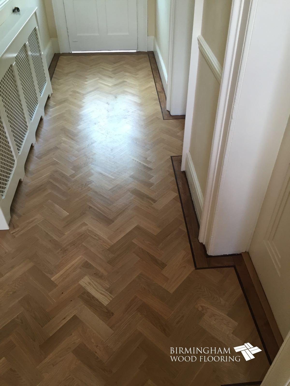 Parquet-floor-with-Wenge-Feature-strip-installed-with-order-stained-medium-oak-2