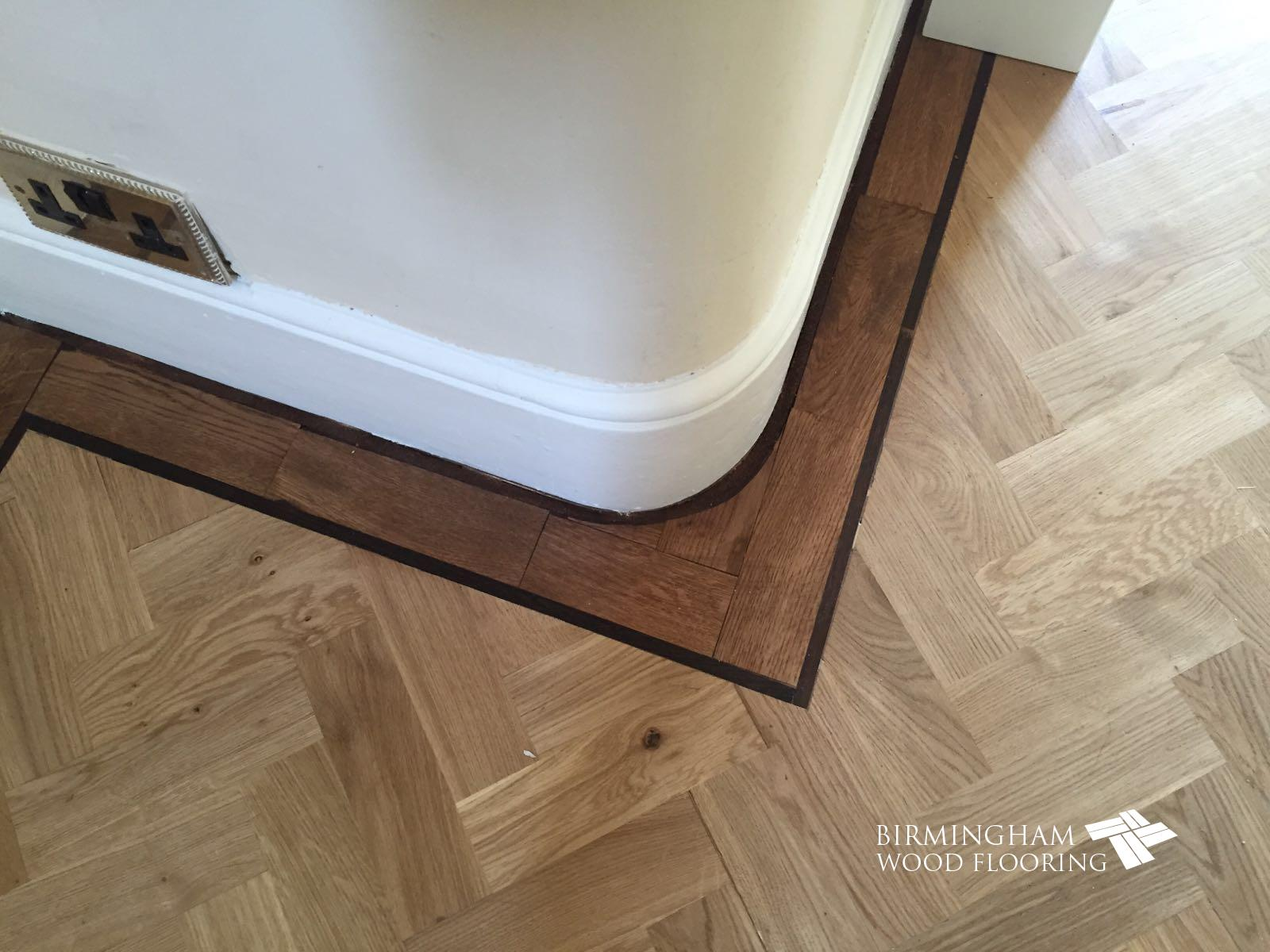 Parquet-floor-with-Wenge-Feature-strip-installed-with-order-stained-medium-oak-3