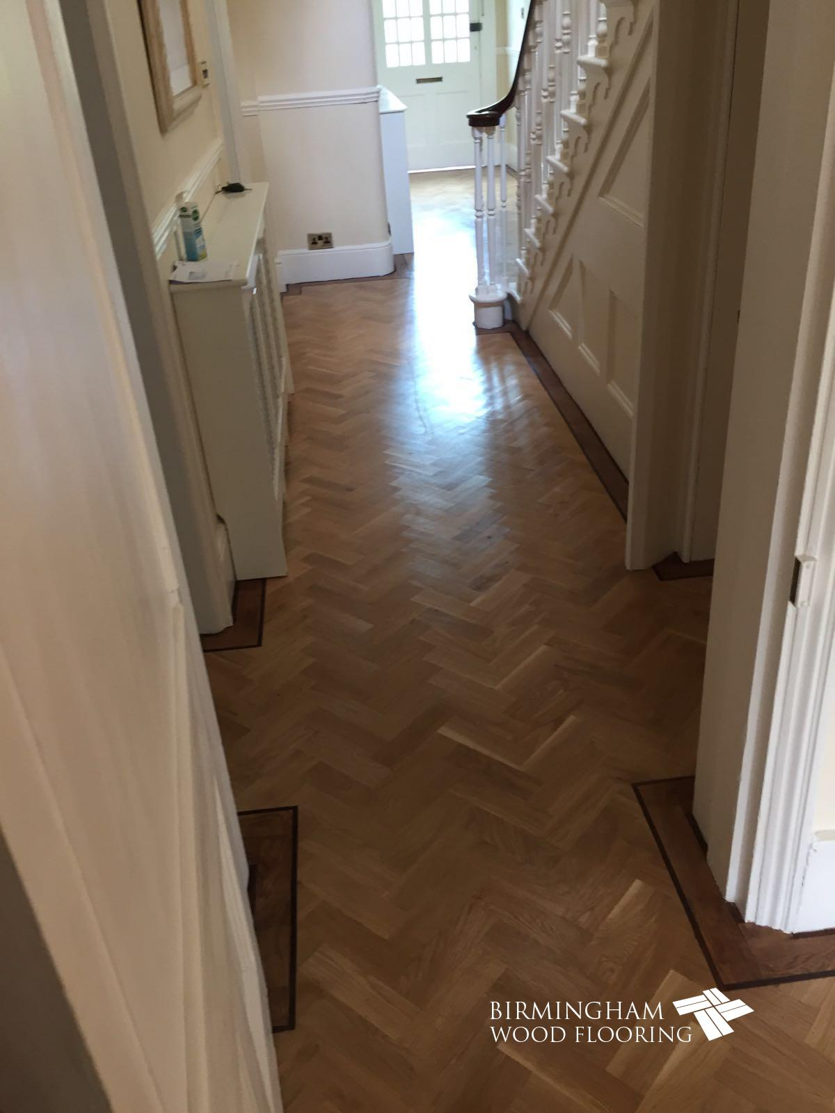 Parquet-floor-with-Wenge-Feature-strip-installed-with-order-stained-medium-oak-6